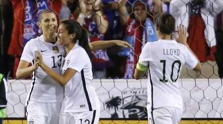 United States' Alex Morgan (13) is congratulated by