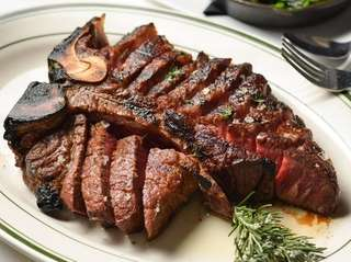 The porterhouse steak for two with sides of