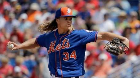 Noah Syndergaard throws during the first inning