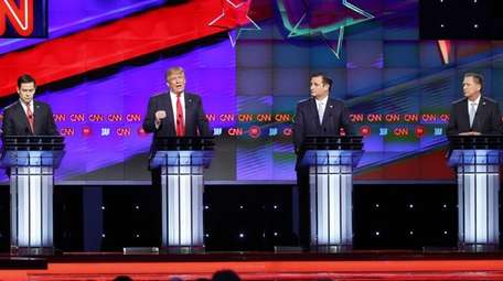Republican presidential candidate Donald Trump speaks as rivals
