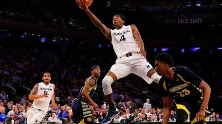 Xavier guard Edmond Sumner attempts a layup against