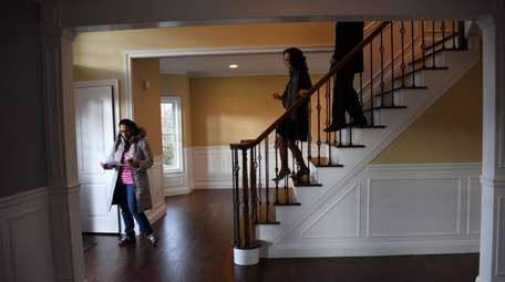 Prospective homebuyer Sarah Jafri of Hicksville, left, tours