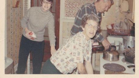The Samodulski family works at its Hotpoint stove