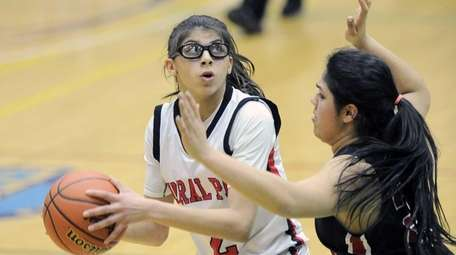 Floral Park's Faith Balletta (2) is defended by