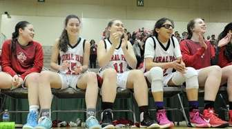 Floral Park players celebrate a 61-55 win against