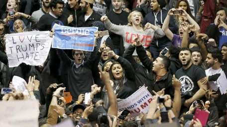Protesters against Republican presidential candidate Donald Trump chant