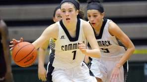 Commack's asey Hearns (1) moves the ball against