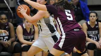Commack's Samantha Miller (11) is defended by Ossining's