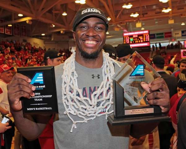 Jameel Warney #20 celebrates while wearing the net