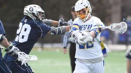 Hofstra midfielder Brian von Bargen is checked by