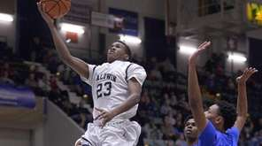 Baldwin's Elijah Bovell, left, drives to the hoop