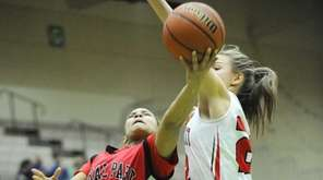 Floral Park Memorial's Kaela Hilaire (1) scores against