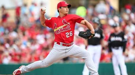 St. Louis Cardinal reliever Seung Hwan pitches during