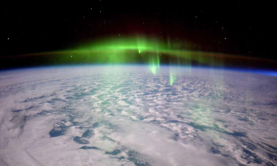A glowing aurora is seen from the International