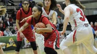 Floral Park Memorial's Kaela Hilaire (1) drives between