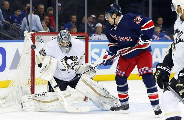 Marc-Andre Fleury of the Pittsburgh Penguins defend a