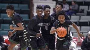 Elmont's Victor Olawoye, right, starts the team on