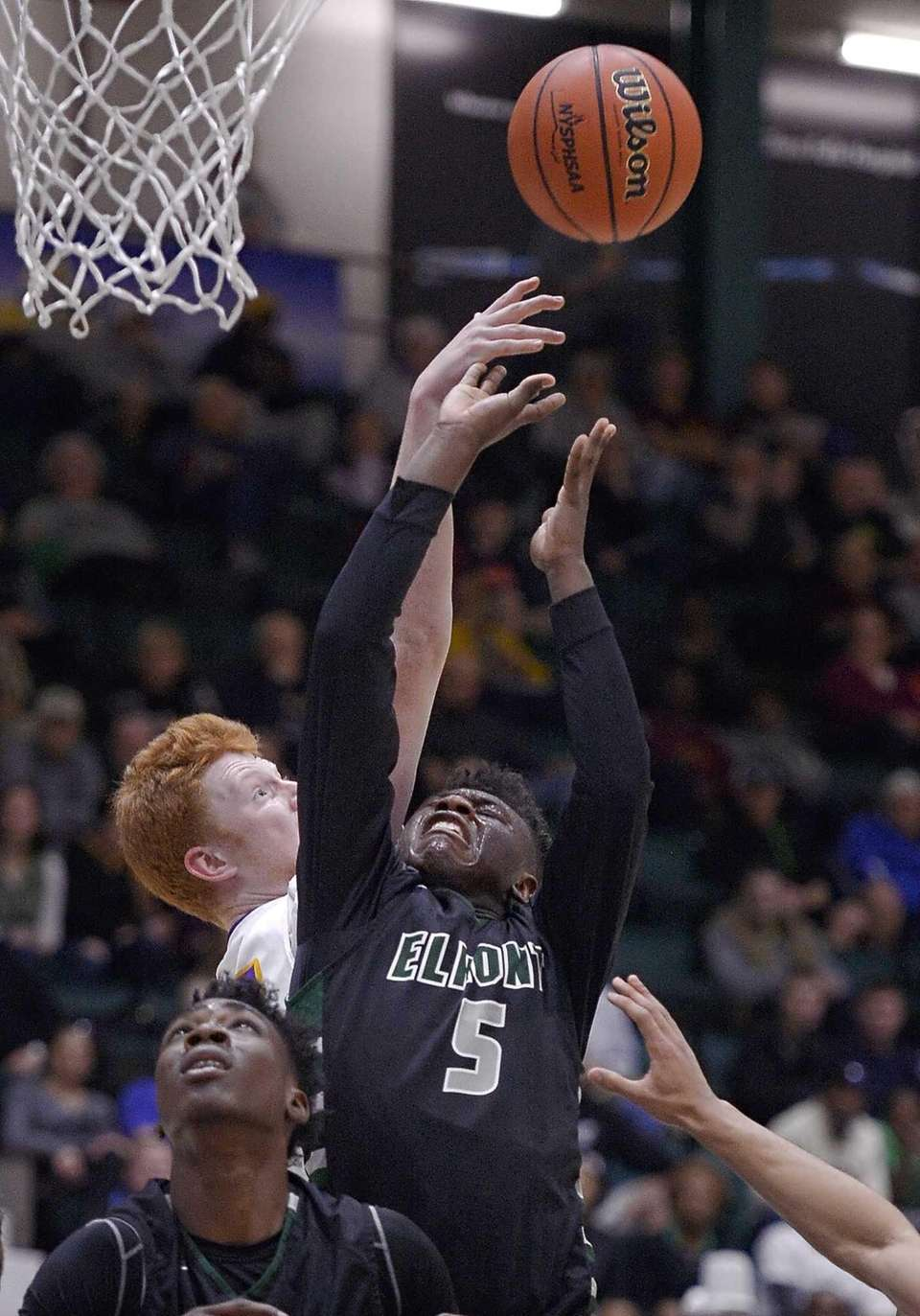 Elmont's Jalen Burgass reaches for a rebound during