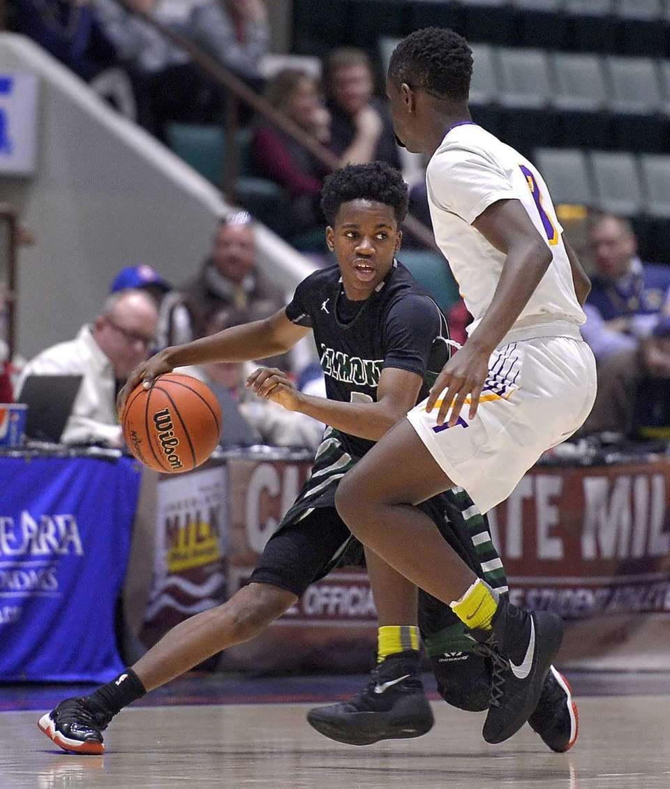 Elmont's Victor Olawoye, left, changes direction against Troy's