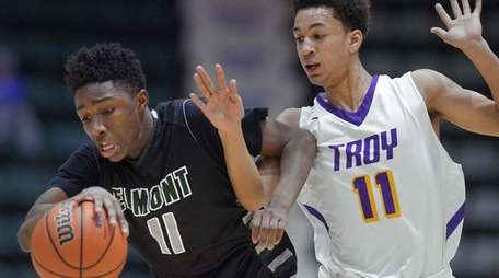 Elmont's Travis Robinson-Morgan shields the ball from Troy's