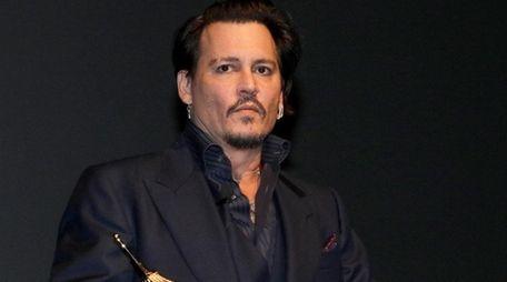 Actor Johnny Depp, seen accepting an award on