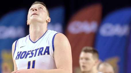Hofstra's Rokas Gustys looks up at scoreboard in