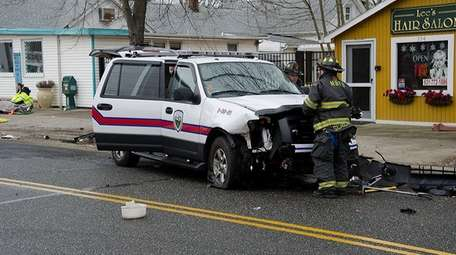 A firefighter at the scene of a crash