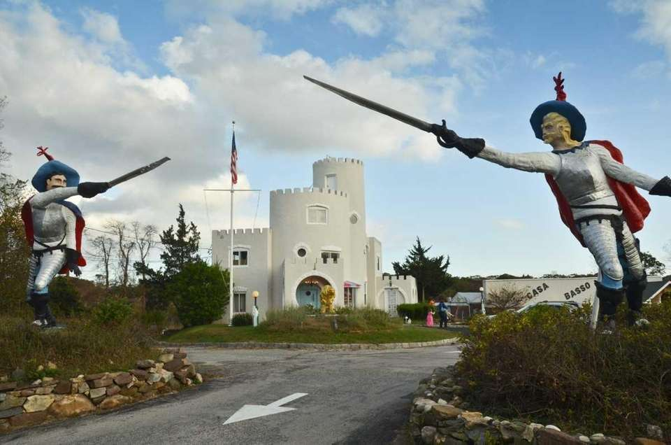 Two large swordsmen stand at the entrance of