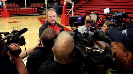 Stony Brook coach Steve Pikiell speaks with the
