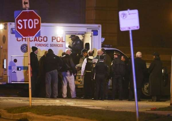 Police investigate the scene of a shootout in
