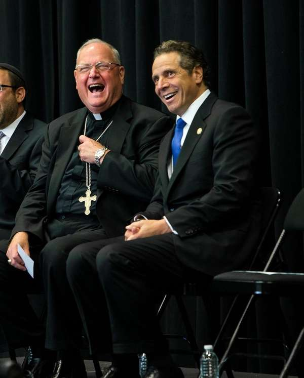 Cardinal Timothy Dolan and Gov. Andrew M. Cuomo,