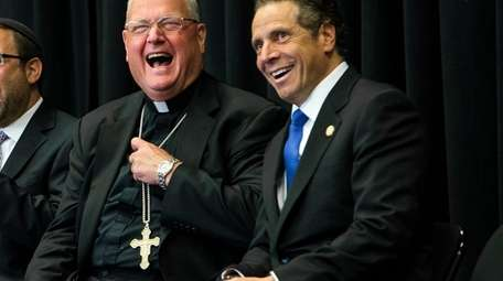 Cardinal Timothy Dolan and Gov. Andrew M. Cuomo,