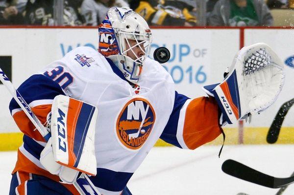 Islanders goalie Jean-Francois Berube can't glove a shot