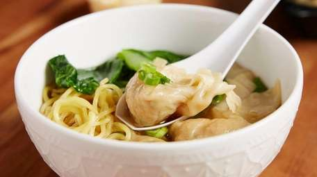 Bok choy and scallions join chicken wontons at