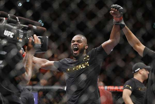 Jon Jones celebrates after defeating Daniel Cormier