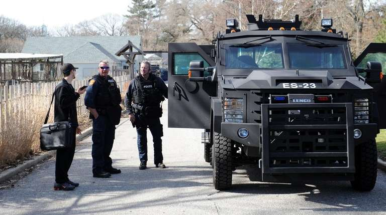 Suffolk County police emergency service officers talk to