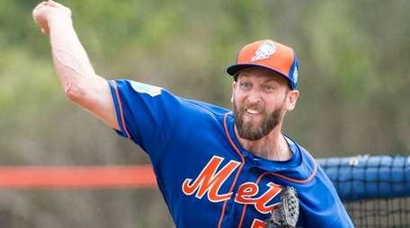 Mets pitcher Jim Henderson throws a live batting