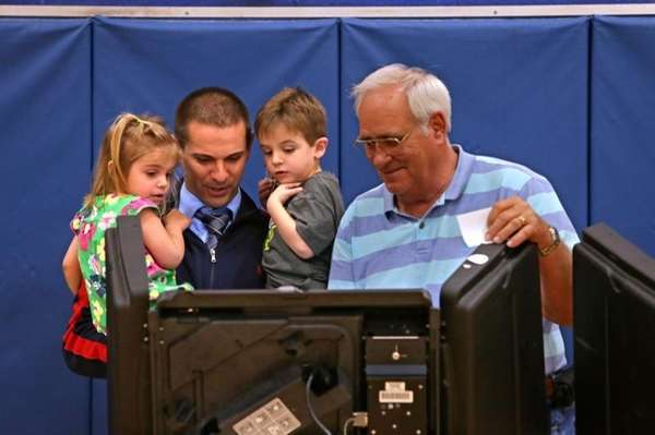 William Sabourin, right, assistant supervisor of voting at
