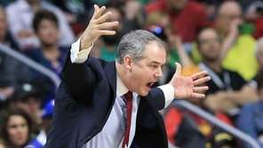 Stony Brook coach Steve Pikiell yells instructions during