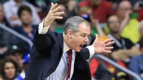 Stony Brook coach Steve Pikiell yells instructions during