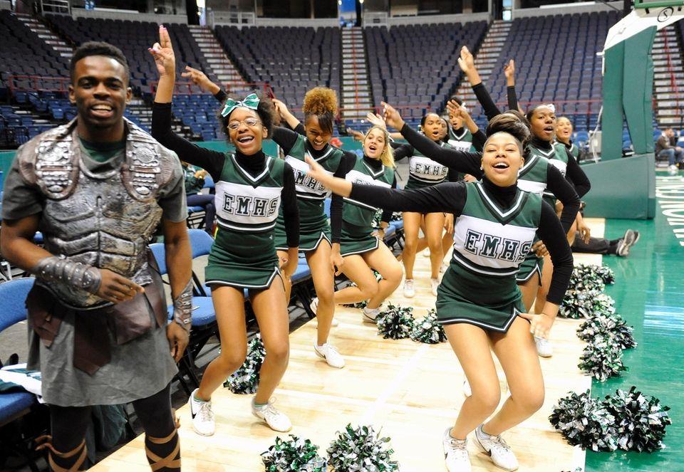 Elmont cheerleaders perform as Elmont plays High School