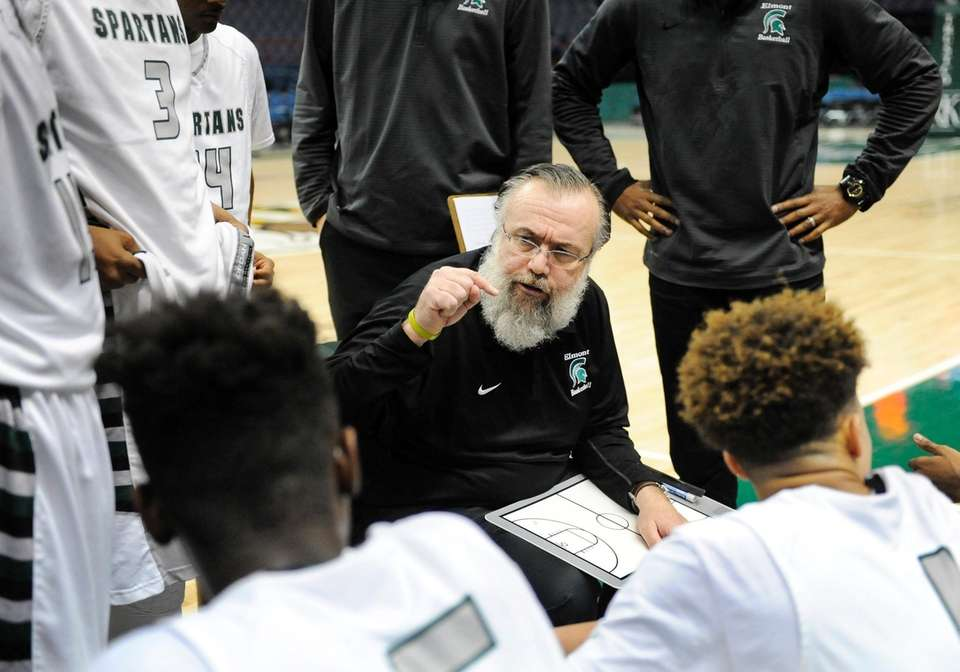 Elmont head coach James Giammattei instructs his players