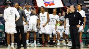 Elmont players react to a 62-44 win against