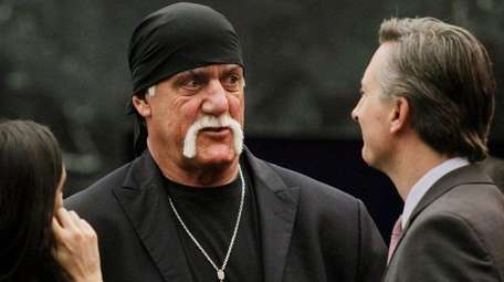 Hulk Hogan talks with his attorneys before the