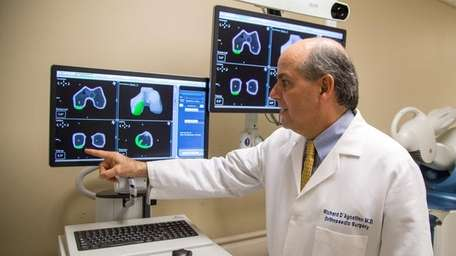 Dr. Richard D'Agostino, chief of orthopedic surgery, demonstrates