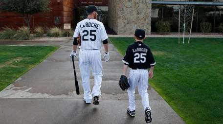 Adam LaRoche and son Drake walk to