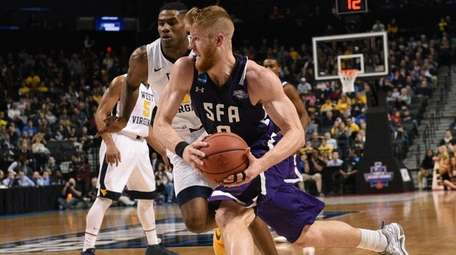 Stephen F. Austin Lumberjacks forward Thomas Walkup drives