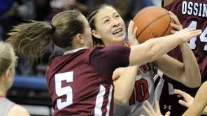 Long Island Lutheran's Grace Stone (10) scores while