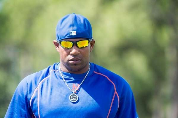 New York Mets outfielder Yoenis Cespedes looks