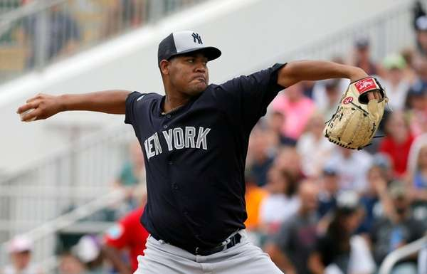 New York Yankees' Ivan Nova works against the